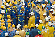 Foreman instructing workers at the Ras Gas LNG refinery in Qatar.