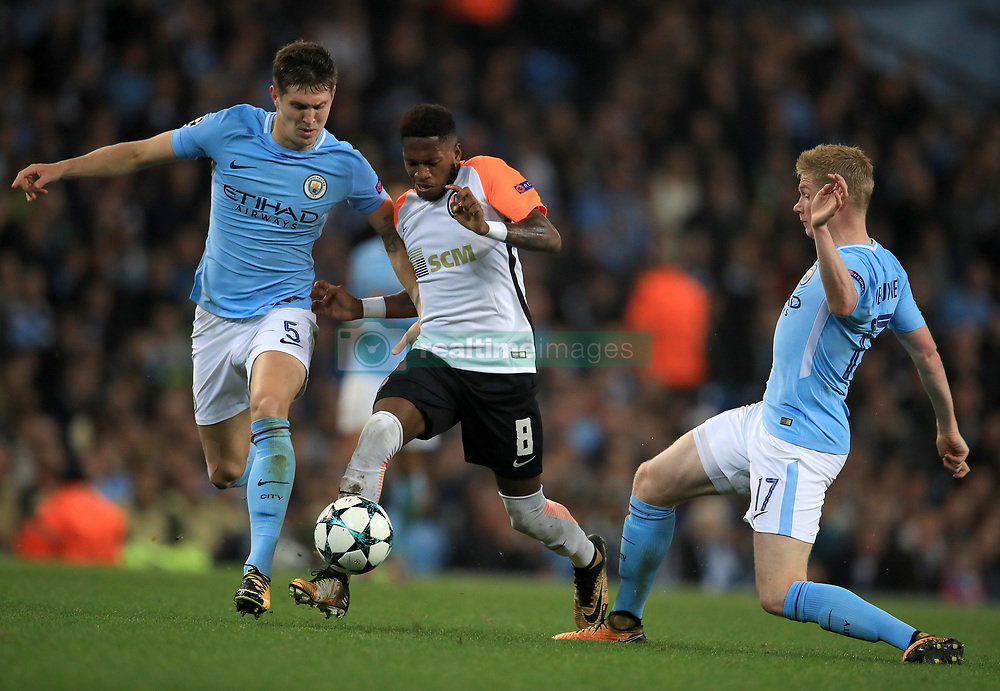 Shakhtar Donetsk's Frederico Fred (centre) battles with Manchester City's John Stones (left) and Kevin Du Bruyne