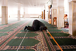 ANTWERP, BELGIUM - OCT-9-2006 - Muslims pray at a mosque in Antwerp.  Immigrants in Belgium and especially those of Arab decent, have come under attack from the Flemish extreme right political party, the Vlaams Belang, which espouses an anti-immigration policy and is trying to capitalize on the clash between Islamic and European values. (Photo © Jock Fistick)