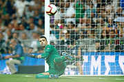 Real Madrid's Spanish defender Sergio Ramos scores a goal as Leganes goalkeeper Cuellar falls during the Spanish championship Liga football match between Real Madrid CF and Leganes on September 1, 2018 at Santiago Bernabeu stadium in Madrid, Spain - Photo Benjamin Cremel / ProSportsImages / DPPI