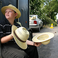 John O' Brien looking for buyers for his sun hats at the annual Spancilhill Horse Fair on Tuesday.<br /> Photograph by Yvonne Vaughan