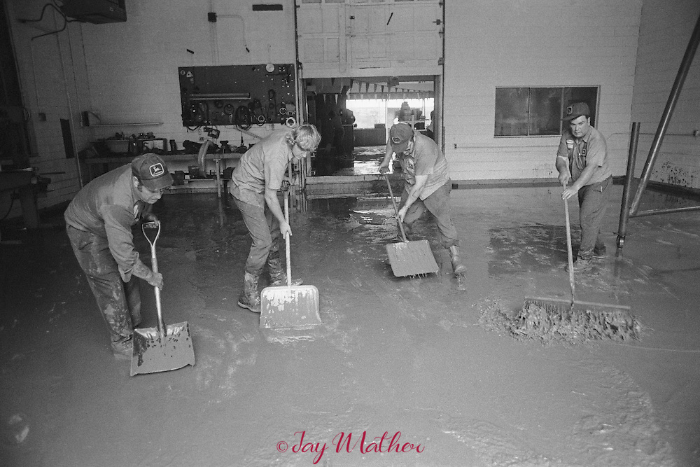 Residents of Marengo and English, Indiana try to recover from the worst flooding in their history.  Over 12 feet of water from the Little Blue River engulfed the towns, July 31, 1979.  This flooding was the result of the junction of four tributaries of similar topography. The peak flow of these reaches the Little Blue River almost simultaneously resulting in flash floods. The tributaries are Camp Fork Creek, Dog Creek, Bird Creek, Hollow Creek, and Brownstone Creek.  Eventually the towns in Crawford County were relocated to higher ground in 1990.