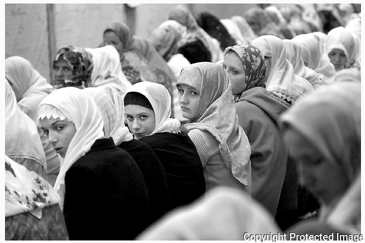 METRO:  Last Friday Ramadan Prayer:.Muslim women cast their glances towards the camera in mid-prayer during Night of Power, last Friday evening at the Kemble Street mosque in Utica.  It is believed during the Night of Power, Muhammad received the first revelation of the Quaran.  The Quaran states that this night is better than a thousand nights.