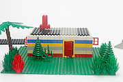 Lego House construction on white background