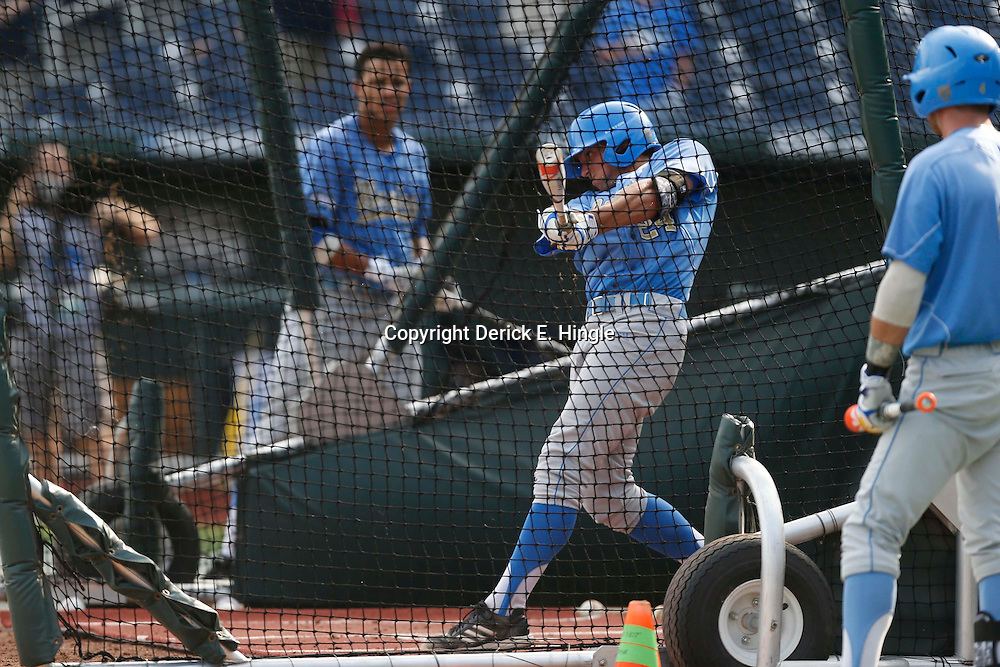 Jun 24, 2013; Omaha, NE, USA; UCLA Bruins center fielder Brian Carroll (24) bats in the batting cage before game 1 of the College World Series finals against the Mississippi State Bulldogs at TD Ameritrade Park. Mandatory Credit: Derick E. Hingle-USA TODAY Sports