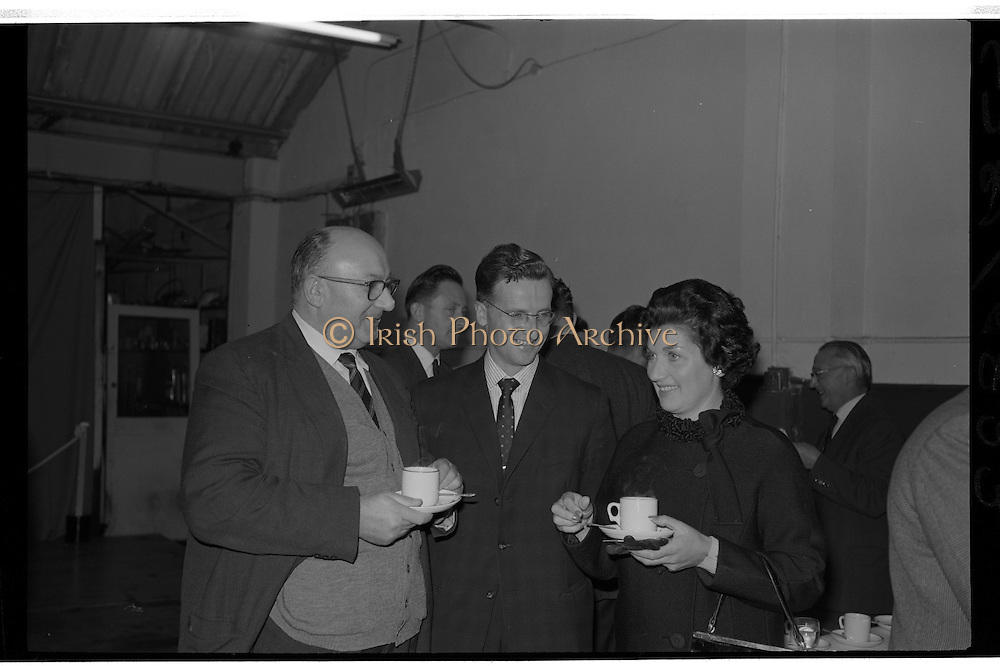 """Launch Of New Ford Corsair..1963..01.10.1963..10.01.1963..1st October 1963..Today saw the launch of a new car to the market. At the Smithfield Motor Company in Drumcondra, Ford launched """"The Corsair"""".,The Corsair was one of the four model Consul range, and shared many of its mechanical components with the Cortina, Classic and Capri. The Corsair had unusual and quite bold styling for its day, with a sharp horizontal V-shaped crease at the very front of the car into which round headlights were inset...Image shows Mr and Mrs Michael Collins of Terenure, Dublin,enjoying a cup of tea after purchasing the new Corsair for both him and her from Mr Joe Murphy, General Manager,Smithfield Motor Company, Drumcondra."""