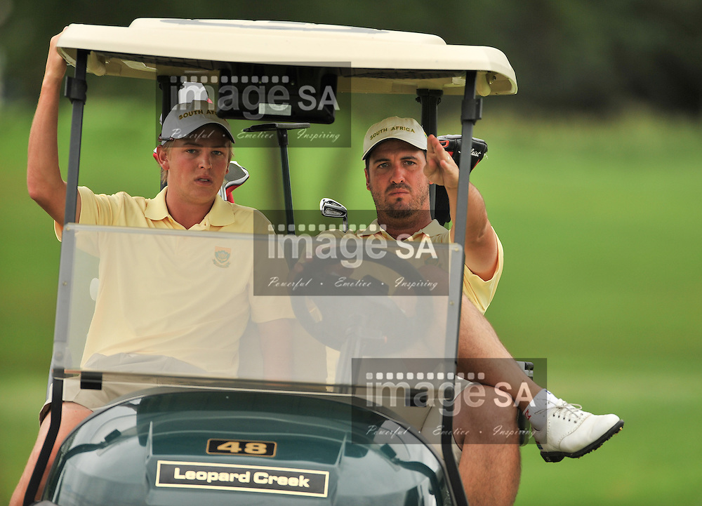 MALELANE, SOUTH AFRICA - Wednesday 18 February 2015, Gerlou Roux (right) of South Africa shows his team mate, Stefan Cronje, the line during the first round foursomes of the annual Leopard Trophy, a two day test between teams of the South African Golf Association and the Scottish Golf Union, at the Leopard Creek Golf Estate.<br /> Photo Roger Sedres/ Image SA