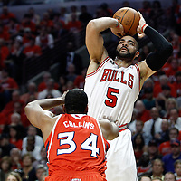 10 May 2011: Chicago Bulls power forward Carlos Boozer (5) takes a jump shot over Atlanta Hawks center Jason Collins during the Chicago Bulls 95-83 victory over the Atlanta Hawks, during game 5 of the Eastern Conference semi finals at the United Center, Chicago, Illinois, USA.