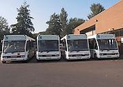 School transport minibus fleet in depot, Bath, Somerset, England