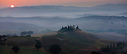 Typical Tuscan homestead, Il Belvedere, and landscape at San Quirico d'Orcia in Val D'Orcia, Tuscany, Italy RESERVED USE - NOT FOR DOWNLOAD - FOR USE CONTACT TIM GRAHAM