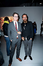 Left to right, Max Valo and Johan Lindeberg at a private view of Nicolas Pol's paintings entitled 'Mother of Pouacrus' held at The Dairy, Wakefield Street, London WC1 on 14th October 2010.