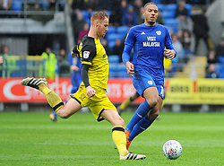 Tom Naylor of Burton Albion under pressure from Kenneth Zohore of Cardiff City - Mandatory by-line: Nizaam Jones/JMP- 30/03/2018 -  FOOTBALL -  Cardiff City Stadium- Cardiff, Wales -  Cardiff City v Burton Albion - Sky Bet Championship