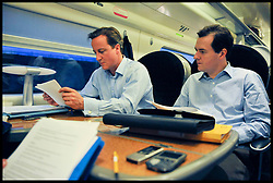 Leader of the Conservative Party David Cameron and George Osborne Shadow Chancellor of the Exchequer working on the train to the Conservative Party Conference, October 3, 2009 Picture by Andrew Parsons / i-Images