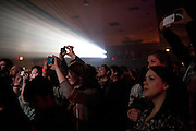 Fans take photos as The XX performs live at the Granada Theater on Wednesday, February 13, 2013 in Dallas, Texas. (Cooper Neill/The Dallas Morning News)