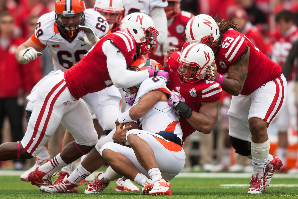 October 5, 2013: Linebacker David Santos (41), defensive tackle Thad Randle (53) of , and defensive end Randy Gregory (44) of the Nebraska Cornhuskers tackle quarterback Nathan Scheelhaase (2) of the Illinois Fighting Illini at Memorial Stadium in Lincoln, Nebraska. Nebraska defeated Illinois 39 to 19.