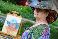 Johanna Kloeter of Belvedere, New Jersey poses for painter Katalin Luczay (NOT SHOWN) during the start of Doylestown Art Days at the Doylestown Historical Society Thursday June 4, 2015 in Doylestown, Pennsylvania.  (Photo by William Thomas Cain/Cain Images)