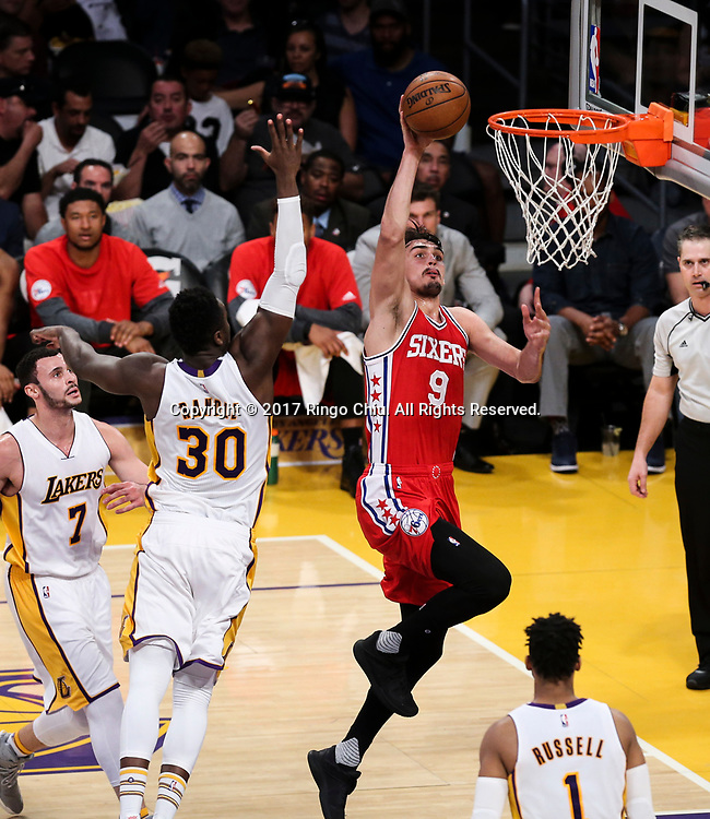 Philadelphia 76ers forward Dario Saric (#9) goes up for a slam dunk against Los Angeles Lakers during an NBA basketball game Tuesday, March 12, 2017, in Los Angeles. <br /> (Photo by Ringo Chiu/PHOTOFORMULA.com)<br /> <br /> Usage Notes: This content is intended for editorial use only. For other uses, additional clearances may be required.