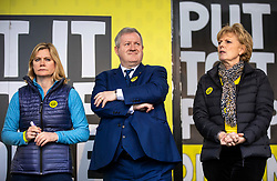 "© Licensed to London News Pictures. 23/03/2019. London, UK. Justine Greening (L), Ian Blackford (C) and Anna Soubry (R) on stage in Parliament Square after an estimated one million people marched through central London to demand that government allow a ""People's Vote"" on the Brexit deal. Several key votes will be held in Parliament in the coming week. Photo credit: Rob Pinney/LNP"
