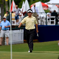 2009 April 26: James Oh of Lakewood, CA walks onto the greet at the 17th hole during the final round of the Zurich Classic of New Orleans PGA Tour golf tournament played at TPC Louisiana in Avondale, Louisiana.