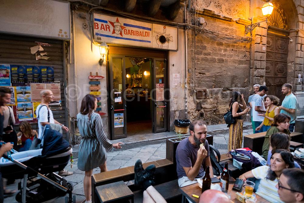 Aperitif time in Via Paternostro. The famous Garibaldi bar
