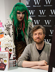 Charlie Brooker (with fan) book signing.  Columnist and TV presenter, known for his misanthropic style of writing, signs copies of his latest book 'I Can Make You Hate', a collection of his best known rants.  Waterstone's, The Plaza, 120 Oxford Street, London, United Kingdom, November 2, 2012. Photo by Nils Jorgensen / i-Images.