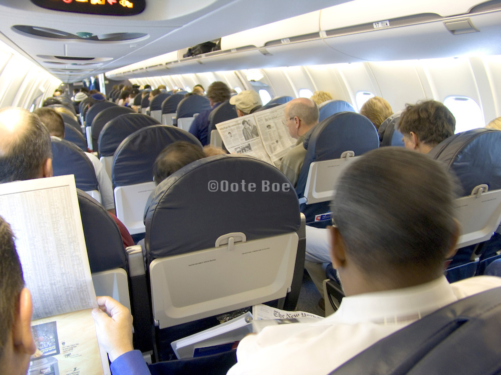 Medium sized airplane with commuting business people.