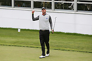 Chris Wood punches the air after finishing his round on the 18th hole during the BMW PGA Championship at Wentworth Club, Virginia Water, United Kingdom on 29 May 2016. Photo by Phil Duncan.