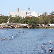 BOSTON, MASSACHUSETTS - OCTOBER 21: Crews in action during The 53rd Head of the Charles Regatta on the Charles River which separates Boston and Cambridge, Massachusetts, USA. The Head of Charles, which began in 1965, attracts over 11,000 athletes from around the globe. The course is 3 miles (4,800 meters) long and stretches from the start at Boston University's DeWolfe Boathouse near the Charles River Basin, passing Harvard University to the finish just after the Eliot Bridge. Boston, Massachusetts. 21st October 2017. (Photo by Tim Clayton/Corbis via Getty Images)