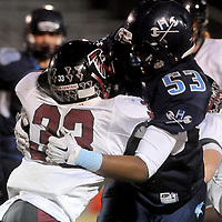 Hoggard's Omar Jones tackles South Central High School's Shawn Furlow in the first round of football playoffs Friday November 14, 2014. (Jason A. Frizzelle)