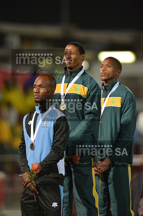 DURBAN, SOUTH AFRICA - JUNE 24: Ruswahl Samaai smiles during the playing of the South African national anthem after receiving their medals during the afternoon session of day 3 of the CAA 20th African Senior Championships at Kings Park Athletic stadium on June 24, 2016 in Durban, South Africa. (Photo by Roger Sedres/Gallo Images)