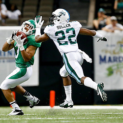 Oct 5, 2013; New Orleans, LA, USA; North Texas Mean Green wide receiver Brelan Chancellor (3) catches a pass over Tulane Green Wave cornerback Jordan Sullen (22) during the second half at Mercedes-Benz Superdome. Tulane defeated North Texas 24-21. Mandatory Credit: Derick E. Hingle-USA TODAY Sports