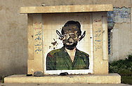A vandalized portrait of Saddam covered in feces and with several shoes that had been thrown at it was located along a road in the northern Iraqi city of Kirkuk.  (Alan Lessig/Air Force Times)