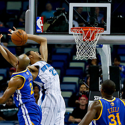 Mar 18, 2013; New Orleans, LA, USA; Golden State Warriors point guard Jarrett Jack (2) fouls New Orleans Hornets power forward Anthony Davis (23) as he attempts a dunk during the second half of a game at the New Orleans Arena. The Warriors defeated the Hornets 93-72.  Mandatory Credit: Derick E. Hingle-USA TODAY Sports