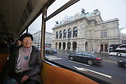 Vienna. Prof. Dr. Helga Nowotny, Vienna Science and Technology Fund (WWTF), President of the European Research Council (ERC), in a tramway going around Ringstrasse, here passing the Staatsoper (State Opera).