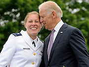 Newly commissioned officer Erin Talbot poses for a photograph with Vice President Joe Biden during commencement for the United States Coast Guard Academy in New London, Conn. (AP Photo/Jessica Hill)