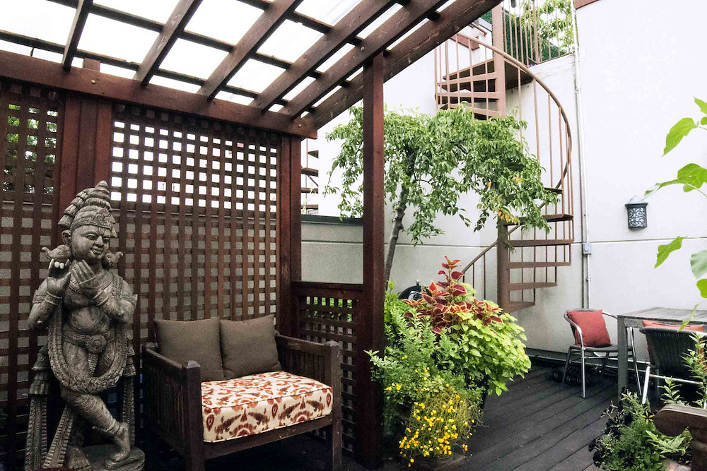 Brooklyn rooftop terrace with cabana and secret container for Terrace garden design