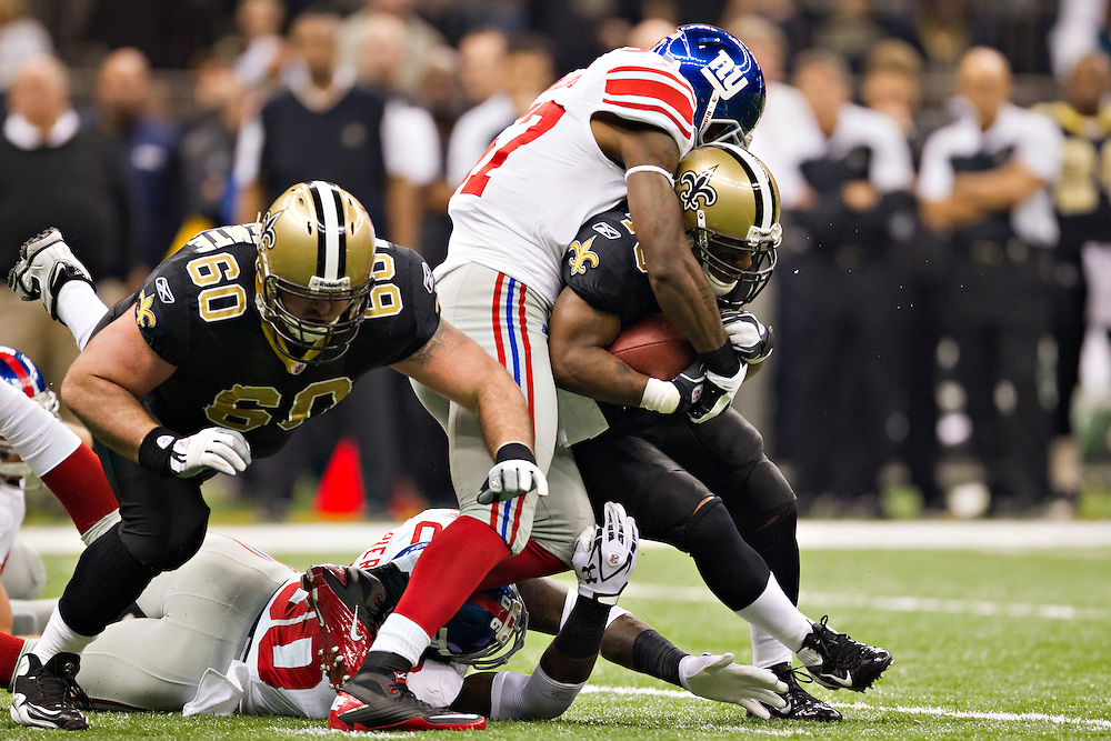 NEW ORLEANS, LA - NOVEMBER 28:   Darren Sproles #243 of the New Orleans Saints is tackled by Linval Joseph #97 of the New York Giants at Mercedes-Benz Superdome on November 28, 2011 in New Orleans, Louisiana.  The Saints defeated the Giants 49-24.  (Photo by Wesley Hitt/Getty Images) *** Local Caption *** Darren Sproles; Linval Joseph