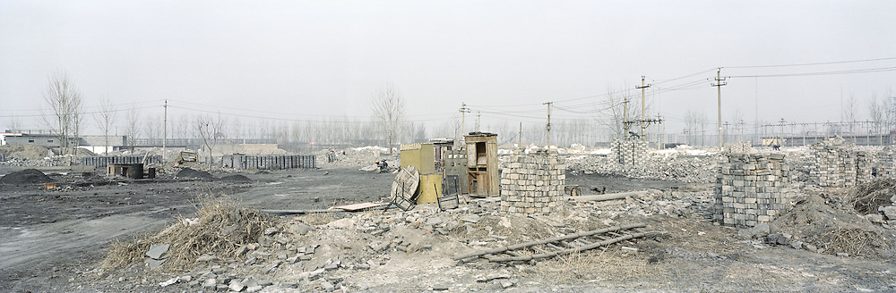 A residential area of a village on the outskirts of the city has been demolished to make way for new development. The number of dwellers in Chinese cities is due to outstrip its rural population over the next five years. The shift has major implications for the government at a time when Chinese cities are already struggling to cope with overcrowding, overloaded infrastructure and a widening rich-poor gap. Linfen, Shanxi, China. 2010