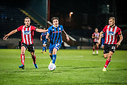 Oliver Rathbone of Rochdale AFC is chased down by Harry Toffolo of Lincoln City and Harry Anderson of Lincoln City during the EFL Sky Bet League 1 match between Rochdale and Lincoln City at the Crown Oil Arena, Rochdale, England on 17 September 2019.