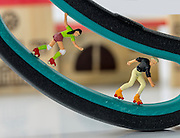 Little world is the creation of Photographer Chris Willemsen, who creates these eye catching situations around everyday objects using children's toys<br /> <br /> Photo shows: Scissor Skating <br /> ©Exclusivepix Media