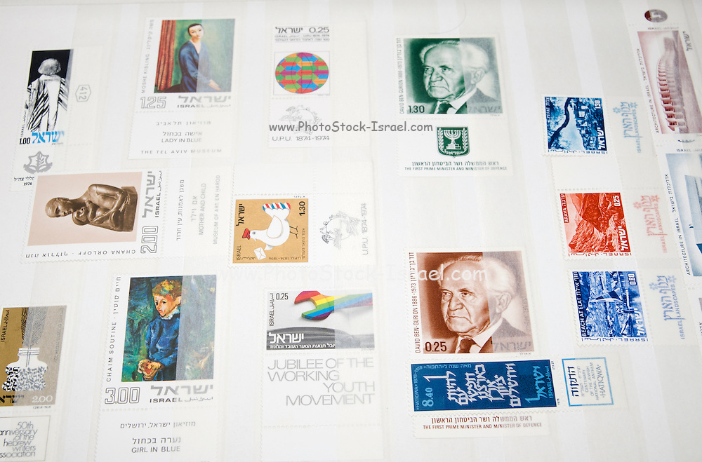 A stamp album with a collection of Israeli stamps