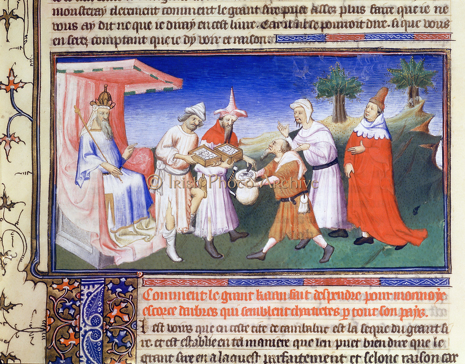 Marco Polo (1254-1324) Venetian traveller and merchant. 'Book of Marvels ...' early 15th century manuscript illustrated by Masters Boucicaut and Bedford. Kublai Khan (1214-94)  paying for his purchases.