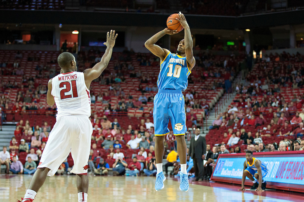 FAYETTEVILLE, AR - NOVEMBER 13:  Shawn Prudhomme #10 of the Southern University Jaguars shoots a jump shot over Manuale Watkins #21 of the Arkansas Razorbacks at Bud Walton Arena on November 13, 2015 in Fayetteville, Arkansas.  The Razorbacks defeated the Jaguars 86-68.  (Photo by Wesley Hitt/Getty Images) *** Local Caption *** Shawn Prudhomme; Manuale Watkins