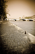 Cobblestone quay along the Seine River, Paris, France