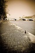 Cobblestone quay along the Seine River, Paris, France