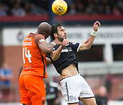 July 30th 2017, Dundee, Scotland; Betfred Cup football, group stages, Dundee versus Dundee United; Dundee United's William Edjenguelea and Dundee&rsquo;s Sofien Moussa battle int he air<br /> <br />  - Picture by David Young - www.davidyounghoto@gmail.com - email: davidyoungphoto@gmail.com