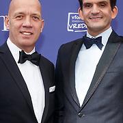 NLD/Amsterdam/20151011 - Inloop premiere De Tweeling, Maurice Wijnen en partner Ronald den Ouden