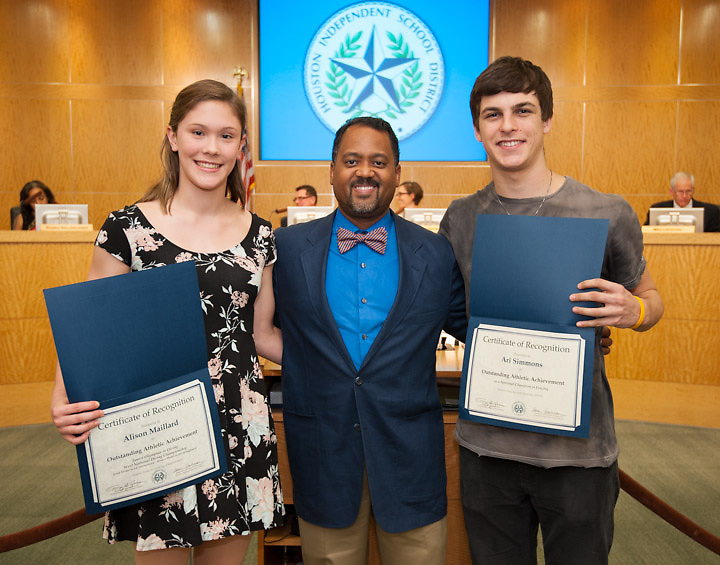 Carnegie Vanguard High School principal Ramon Moss, center, poses with Alison Maillard, left, and Ari Simmons, right, after they were recognized for academic and athletic achievement during a Board of Education meeting, May 9, 2013.