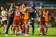 Gabriele Cioffi, Head Coach of Crawley Town FC celebrates the win for Crawley with David Sesay (Crawley Town) the EFL Cup match between Crawley Town and Norwich City at The People's Pension Stadium, Crawley, England on 27 August 2019.