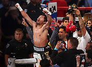 Manny Pacquiao of the Philippines celebrates being new WBO welterweight champion by defeating Jessie Vargas of Las Vegas during their title fight at the Thomas & Mack Center in Las Vegas.